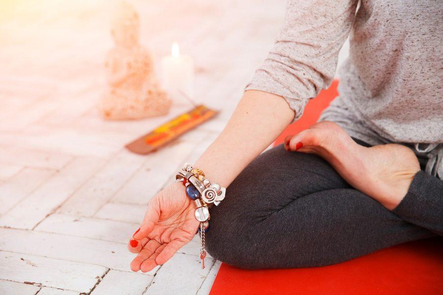 woman-having-yoga-meditation-P62WSVR-min.jpg